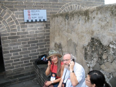 Joanne and Rick with cell phones on the Great Wall