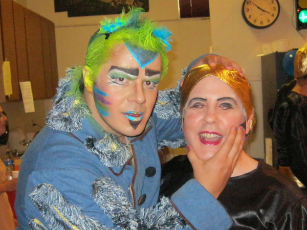 Papageno and Third Priest backstage