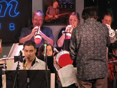 Jennifer Wharton playing bucket-muted bass trombone