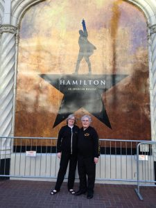 Posing in front of the Hamilton poster